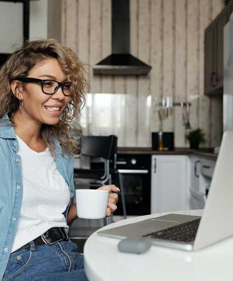 woman with coffee at computer